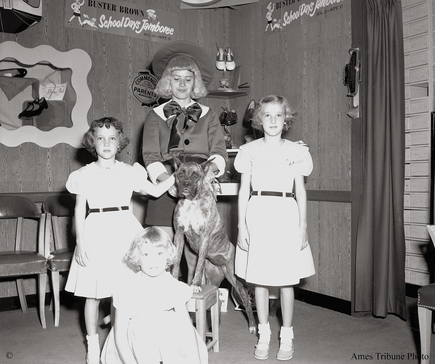 Children appear with Buster Brown at shoe store